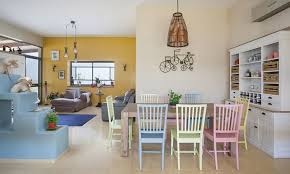 Mediterranean Dining Room With Snazzy Chairs In Pastel Hues