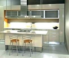 Kitchen With Black Appliances Beige Cabinet Cabinets Stainless Steel Photos