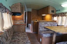 School Bus RV Conversion With Old Upholstery On Cushions Curtains