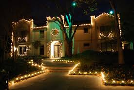 Outdoor Christmas Lighting Decoration In Front Of The House And Around Landscape