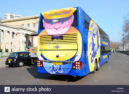 megabus com low cost tickets colourful transport advertisement on back of stagecoach stock