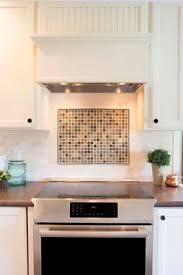 multi colored slate and granite backsplash by 21st century tile in