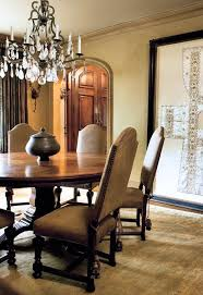 Chandelier Definition With Mediterranean Dining Room Also Arched Doorways Area Rug Crown Molding Faux Finish Nailhead Trim Neutral Colors