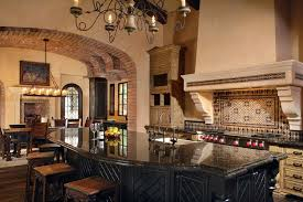 Mediterranean Style Kitchen With Exposed Brick Archway Rustic Dining Island