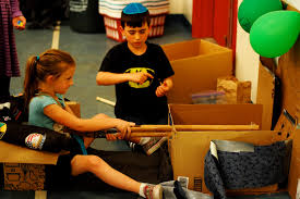 Two Students Play A Shooting Game At The Cardboard Arcade