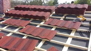 roof installer installing corrugated fiberglass roof panels sc 1