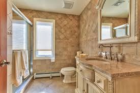 country bathroom with flat panel cabinets by theresa kuyl