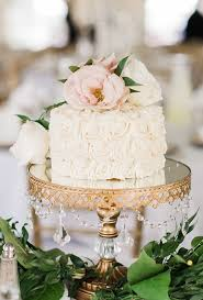 A Glam Wedding Cake Goes Country Chic With Frosting Floral Details