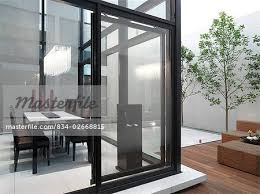 Open Sliding Glass Door To Modern Dining Room