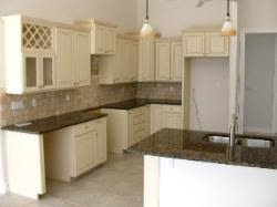 cabinets painted ivory with pewter glaze baltic brown granite and