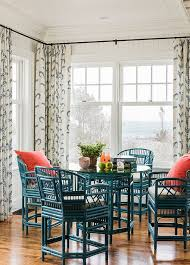 Bright Open Coastal Dining Space Featuring Bold Teal Chairs And Table