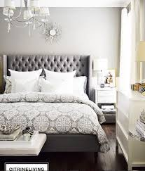 White And Mirrored Furniture With The Grey Bed