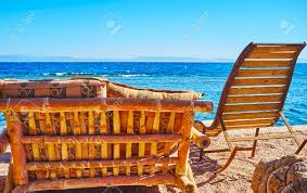 The Nice Beach Of Dahab With Cozy Rocking-chairs And Bamboo Benches.. Costway Outdoor Rocking Lounge Chair Larch Wood Beach Yard Patio Lounger W Headrest 1pc Fniture For Barbie Doll Use Of The Kids Beach Chairs To Enhance Confidence In Wooden Folding Camping Chairs On Wooden Deck At Front Lweight Zero Gravity Rocker Backyard 600d South Sbr16 Sheesham Relaxing Errecling Foldable Easy With Arm Rest Natural Brown Finish Outdoor Rocking Australia Crazymbaclub Lovable Telescope Casual Telaweave