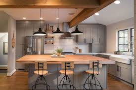 gray island with wooden countertop industrial bar stools 3 black