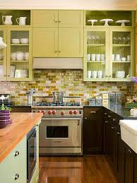 kitchen kitchen with multicolored subway tile backsplash and pale