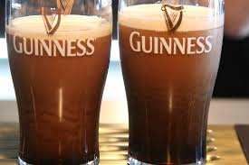 Fresh pint of Guinness changing from a light caramel color to deep