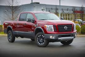 Nissan Gives Titan XD A $40K Sticker | Medium Duty Work Truck Info Nissan Titan Xd Morries Brooklyn Park 2016 Review Notquite Hd Pickup Makes Cannonball Cummins Gets 177 Mpg Comb In Real Testing The New Truck Is Getting 2018 Sv Jacksonville Fl Warrior Concept Pictures Information Specs New Nissan Titan Features Cummins Power News Nissans 2017 Single Cab Will Start Under 300 Roadshow First Drive Autonxt 4wd Crew Sl Diesel Truck Castle Built For Sema