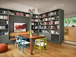 View In Gallery Colorful Collection Of Wishbone Chairs And Gorgeous Gray Bookshelves Add To The Charm This Dining