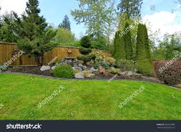 Fenced Backyard Landscape Decorative Trees Blend Stock Photo ... Garden Design With Backyard Landscaping Trees Backyard Fruit Trees In New Orleans Summer Green Thumb Images With Pnic Park Area Woods Table Stock Photo 32 Brilliant Tree Ideas Landscaping Waterfall Pond Stock Photo For The Ipirations Shejunks Backyards Terrific 31 Good Evergreen Splendid Grass Scenic Touch Forest Monochrome Sumrtime Decorating Bird Bath Fountain And Lattice Large And Beautiful Photos To Select Best For