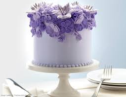 White and purple floral wedding cake