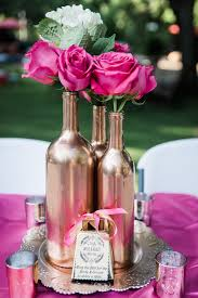 Hot Pink Roses And White Hydrangeas Rose Gold Wine Bottle Center Pieces Mercury Quinceanera CenterpiecesWedding