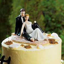Romantic Wedding Couple Lounging On The Beach Figurine Compliment Your Setting With A Beautifully Crafted And Equally Enchanting Cake Topper