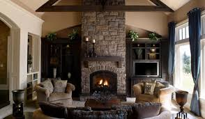 DecorationsStone Fireplace At Winter Living Room With Cream Fabric Sofa And Wooden Coffee Table