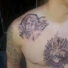 Sacred Heart And Cherub Angel Tattoo On Collarbone