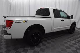 Pre-Owned 2015 Nissan Titan King Cab PRO-4X 4x4 Truck In Wichita ... Nissan Titan 65 Bed With Track System 62018 Truxedo Truxport Trucks For Sale In Edmton 2017 Crew Cab Pricing Edmunds Sales Are Up 274 Percent Over Last Year The Drive 2018 Titan Xd Truck Usa New For Warren Oh Sims 2016nisstitanxd Fast Lane Used 2012 4x4 Crewcab Sl Accident Free Leather Preowned 2013 Pro4x Pickup Cicero 2016 Titans Turbo Diesel Might Be Unorthodox But Its Review Autoguidecom News Partners With Cummins Diesel
