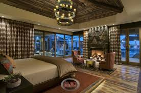 Rustic Master Bedroom With Wood Flooring Floor To Ceiling Windows And Small Sitting