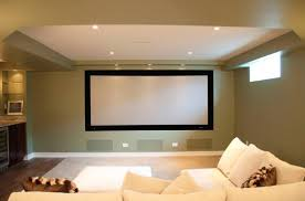 Living Room Mini Home Theatre In Basement Using Dark Green Wall Paint And