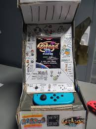 someone turned a switch into this tiny cardboard arcade cabinet