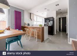 Dining Room Kitchen And Entrance In Contemporary Family House With Minimalist Gray Design Colorful Accents Wooden Furniture