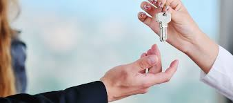 Close Up Of One Person Handing Keys To Another Resources Becoming A First Time Homebuyer