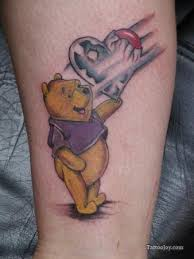 A Cute Love Tattoo That Shows Winnie The Pooh Bear Holding Heart Balloon