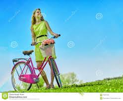 wearing yellow polka dots dress rides bicycle into park