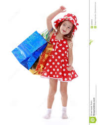 little in a summer dress with polka dots is stock photo