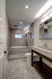 Narrow Bathroom Ideas Pictures by Guest Bathroom With Tub Enclosed Within Glassed In Shower Space
