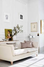 Love The Picture Wall And Cream Sofa In This White Panelled Living Room