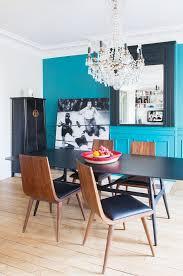 esszimmer mit türkisfarbener wand und bild kaufen