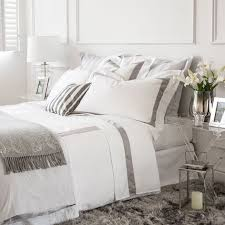 SATIN BED LINEN WITH CONTRASTING RIBBON