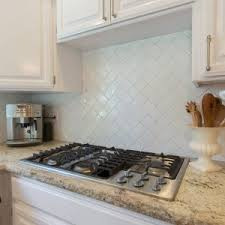 bathroom white daltile subway tile with floating wood cabinets