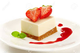 cheesecake with strawberries on white plate Stock