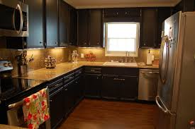 Kitchen Black Cabinets With Amazing Lighting And Elegant Floor
