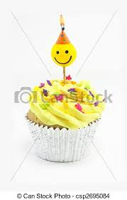 Yellow Cupcake And Smiley Candle Stock