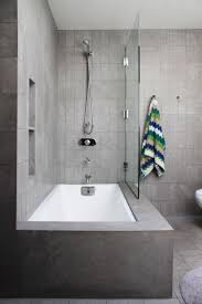 5 Fresh Ways To Shake Up The Look Of A Bathtub/Shower Combo ... Bathroom Tub Shower Ideas For Small Bathrooms Toilet Design Inrested In A Wet Room Learn More About This Hot Style Mdblowing Masterbath Showers Traditional Home Outstanding Bathtub Combo Evil Bay Combination Remodel Marvelous Tile Combos 99 Remodeling 14 Modern Bath Fitter New Base Is Much Easier To Step 21 Simple Victorian Plumbing