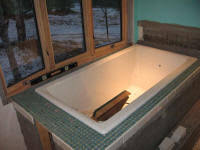Tiling A Bathtub Deck by Building A Log Home In Maine