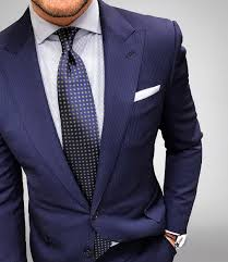 how to wear a blue suit with a white and navy vertical striped