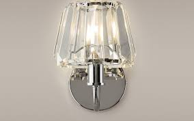 chrome wall light with clear glass shade at