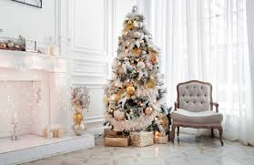 A White And Gold Christmas Tree Theme Including Beautiful Ornaments
